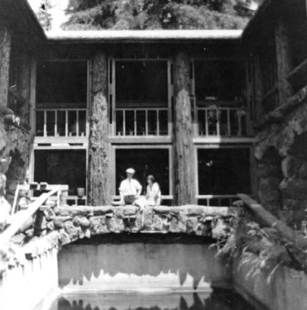Jack and Charmian in the center of Wolf House overlooking the swimming pool which is not yet filled
