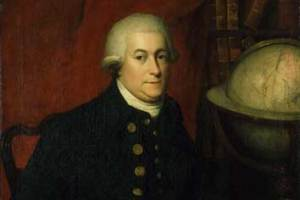 British Explorer  George Vancouver seated next to a globe of the world symbolizing his successful discoveries