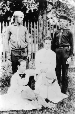 Young Theodore Roosevelt standing on left and Edith Carow seated in front of him in the late 1870's