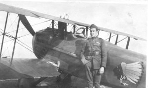 James Norman Hall standing next to his plane.