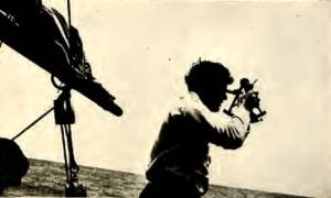 """Jack London takes a """"sighting"""" with sextant."""
