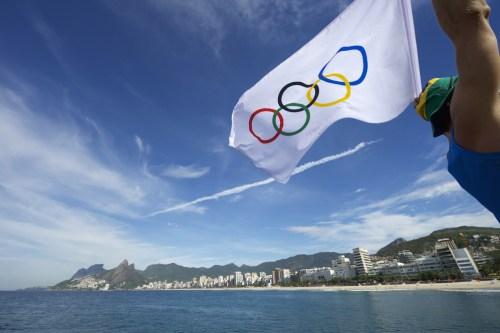Olympic flag flies over Ipanema Beach in Rio de Janeiro, Brazil
