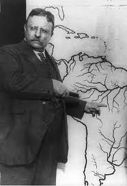 "Theodore Roosevelt explains to the Press Corp, his proposed route down the ""River of Doubt"" in Brazil. It almost cost him his life."