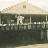 Truck with milk cans outside the Meadows dairy factory.