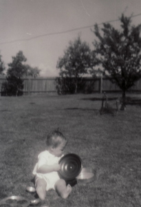 Baby in a backyard at Belconnen.