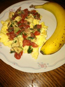 scrambled eggs & avosalsa with a banana