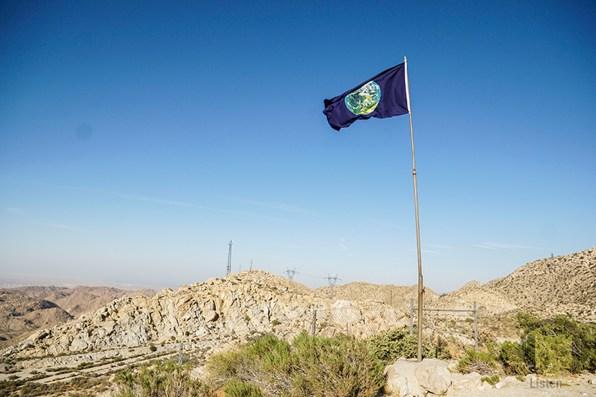 Earth flag waves over Ocotillo desert