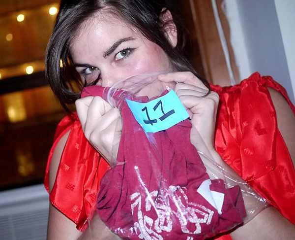 Woman smelling T-shirt