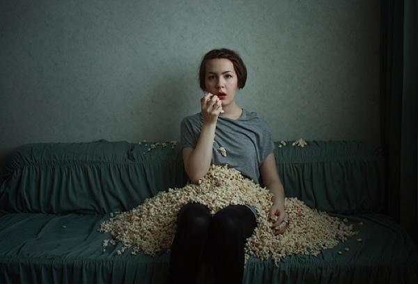 Depressed Girl Eats Popcorn