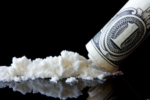 Cocaine and dollar with reflection on black background