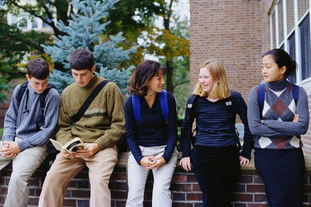Students Sitting on Wall
