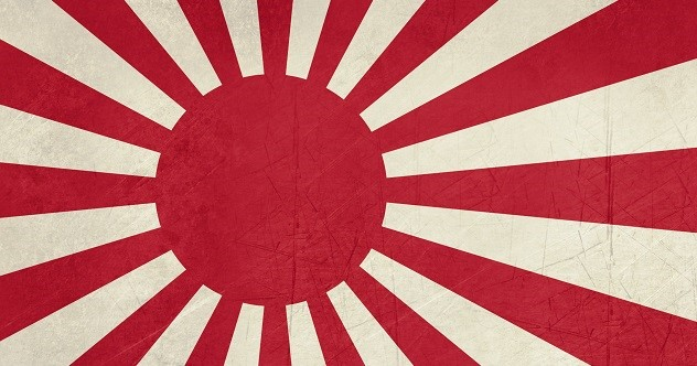 Grunge Rising Sun ensign of Japanese navy in red and white.