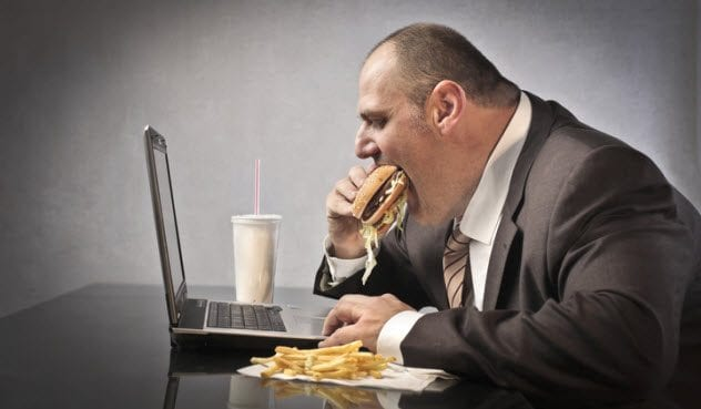 9a-obese-man-using-computer-155511848