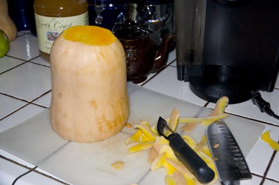 peeling a butternut squash