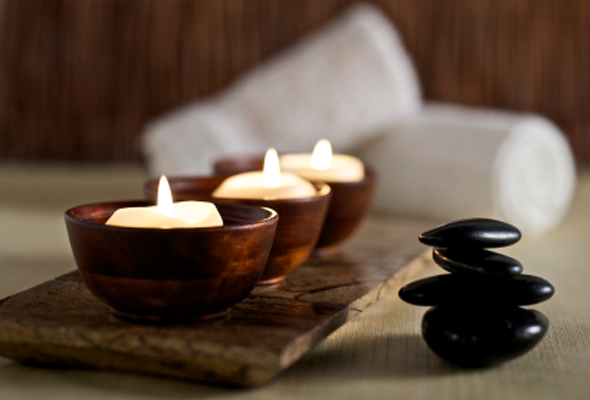 candles and bamboo and balanced stones