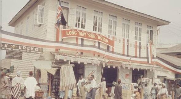 """Ereko Market, Lagos decorated for Queen Elizabeth II's visit to Nigeria in 1956 photo by Carl Mydans"