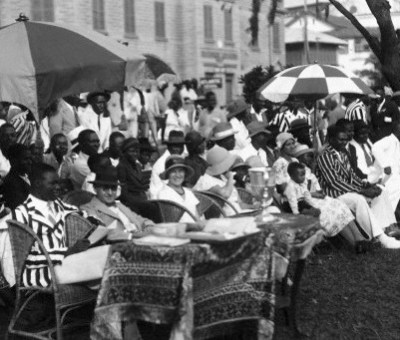 African and European spectators at the Lagos Boat Race Club in Lagos, Africa. --- Image by © Underwood & Underwood/Corbis