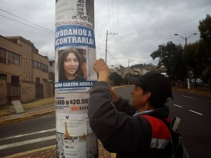 Walter pasting posters in the Paluco neighborhood, in Quito - August 4, 2012.