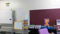 This photo is terribly out of date too. This is the biggest notice board in the classroom. Below it you can see our classroom library (in the baskets)