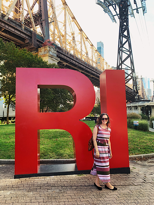 Me, posing in front of the Roosevelt Island sign during my Everywhere, Always tour of New York City