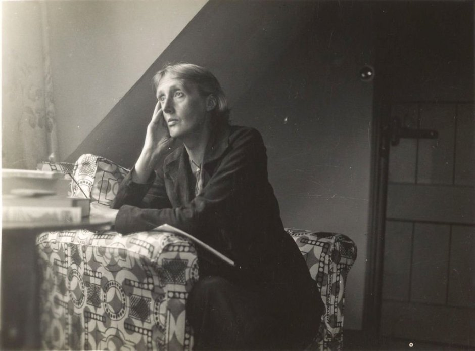 Virginia Woolf sitting in an armchair at Monk's House