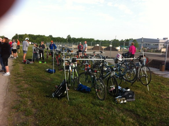 Transition area showing bicycles on racks.