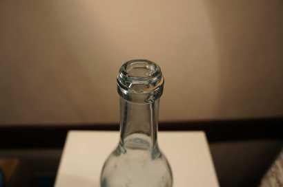 Бутылка стеклянная 0,75 л Товарищество Эйнем Москва из-под сладкой воды; Объем 0,75 л., высота 35 см., без пробки; Город Хобби; Инв.№; 938