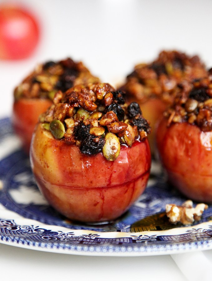 Healthy Baked Apples filled with fresh blackberries and topped with a crispy walnuts, pepitas, sultanas & maple