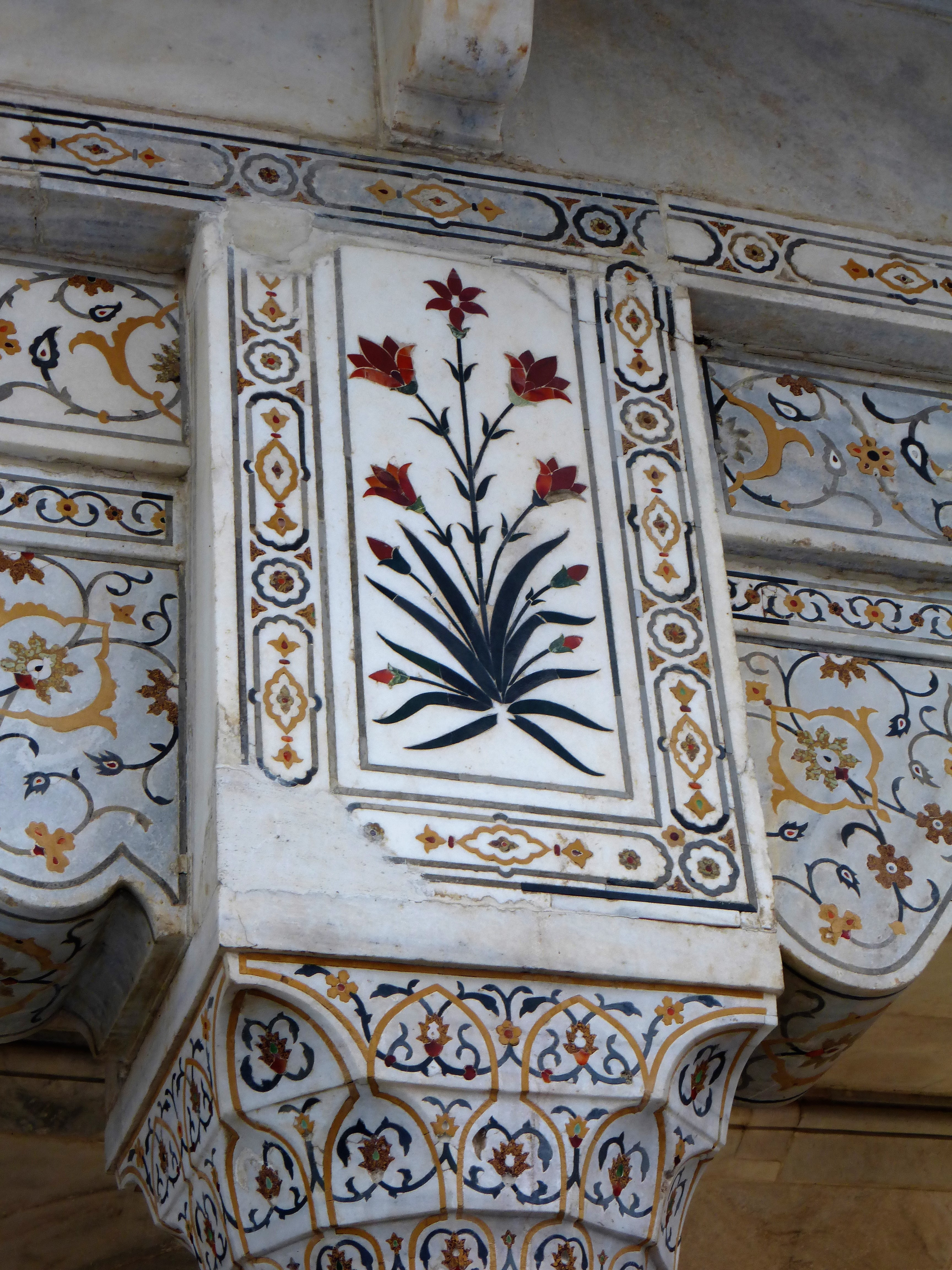 Agra Fort is intricately decorated with precious stones inset into marble