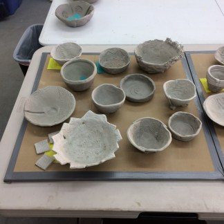 hand-formed clay bowls ready to fire