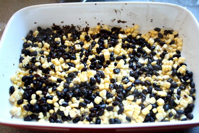 Spread over the infused black beans