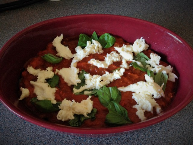 Layer the sauce, basil leaves and mozzarella