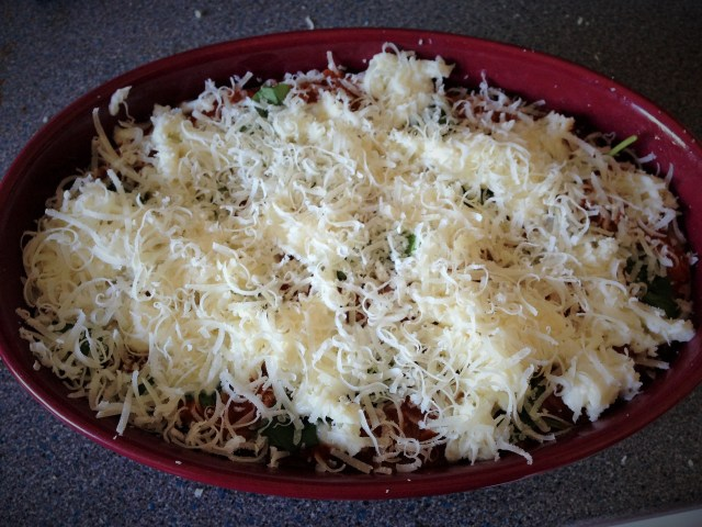 Top with mozzarella and parmesan or vegetarian hard fat cheese & cook 180C Fan for 25-30 minutes until golden