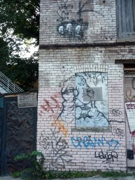 Three heads and a monster, just North of Sullivan Street, in the parking lot East of Spadina