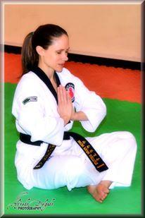Black belt meditating