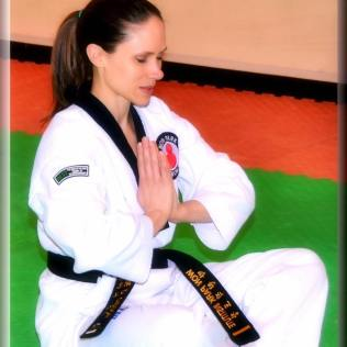 Melanie black belt meditating