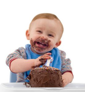 first-birthday-party-cake-eating-by-cute-baby-boy