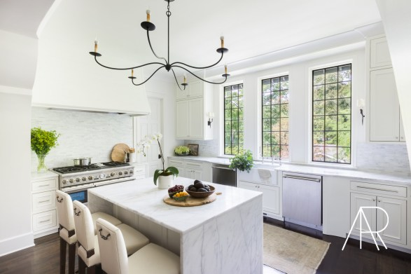 Alyssa Rosenheck White Kitchen with Iron Light Fixture and Stainless Appliances