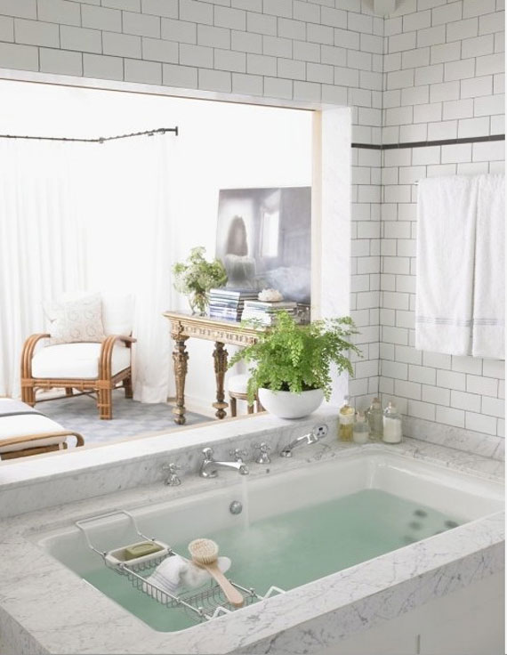 soaking tub with marble deck and chrome faucets