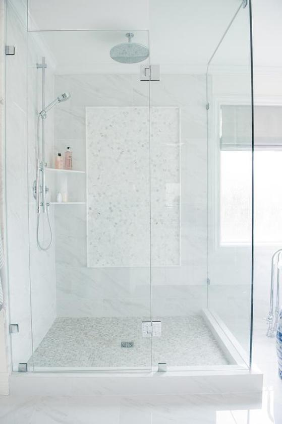 shower with mosaic marble floor and accent wall inlay