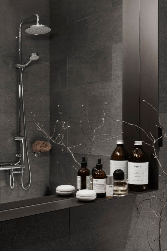 Dark stone shower with ledge product