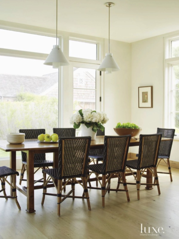Long Wood Farmhouse Table, French Bistro Chairs, White Pendant Lighting, Windows With Transoms, Natural Washed Wood Wide Plank Floors