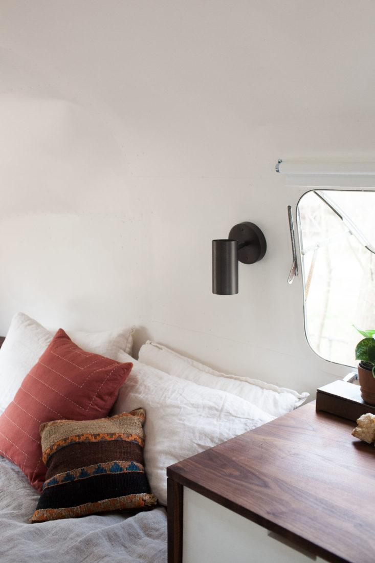 modern-caravan-airstream-remodel-bed-1-733x1100.jpg