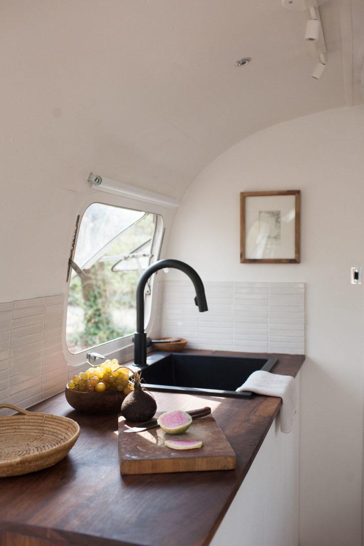 modern-caravan-airstream-remodel-kitchen-sink-733x1100.jpg