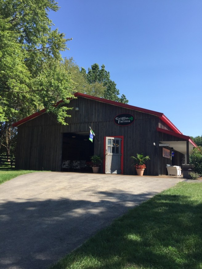 Griffin Farms Barn Exterior with Red Roof and Aged Barnwood Facade