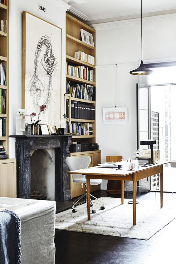 Black Marble Fireplace, Teak Desk, Home Office In Front Of Fire Place Nook, Black and White Art Work