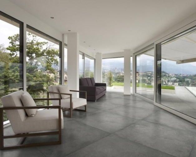 Contemporary Sunroom+Concrete Floors+ Upholstered Outdoor Furniture