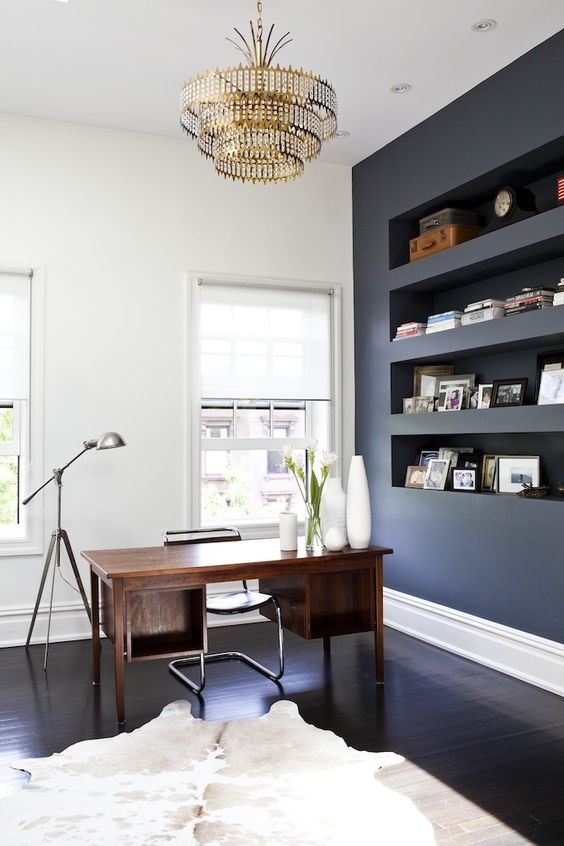 remodelista school house desk, built in wall cubbies, mix of white/black paint for modern decor, statement lighting