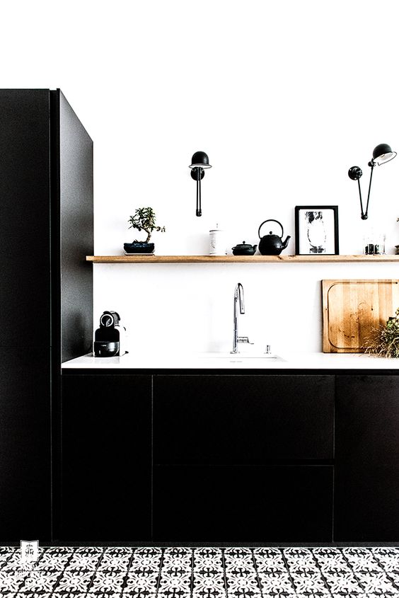 Modern Black Kitchen with Black and White Cement Tile Floor
