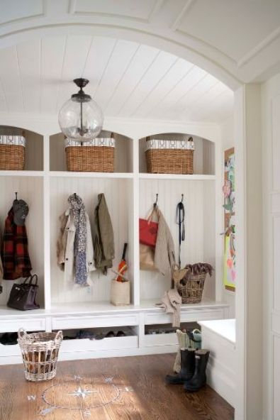 built in storage for coats, baskets, shoes in mudroom